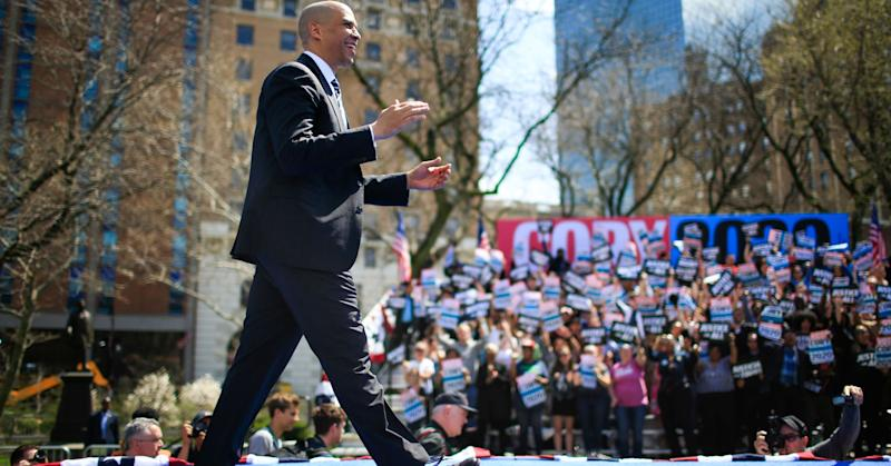 Sen. Cory Booker (D-NJ) and 2020 presidential candidate, greets supporters as he arrives to speak during a campaign event on April 13, 2019 in Newark, New Jersey.