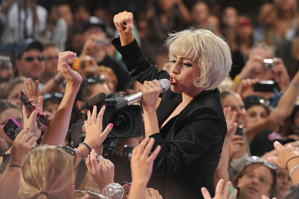 "After scoring 10 million Facebook fans last week, Lady Gaga, who has reportedly rekindled her ""Bad Romance"" with ex-boyfriend Luc Carl, broke another record Friday, attracting a crowd of over 20,000 screaming ""little monsters"" when she performed on the ""Today"" show in NYC. Theo Wargo/<a href=""http://www.wireimage.com"" target=""new"">WireImage.com</a> - July 9, 2010"