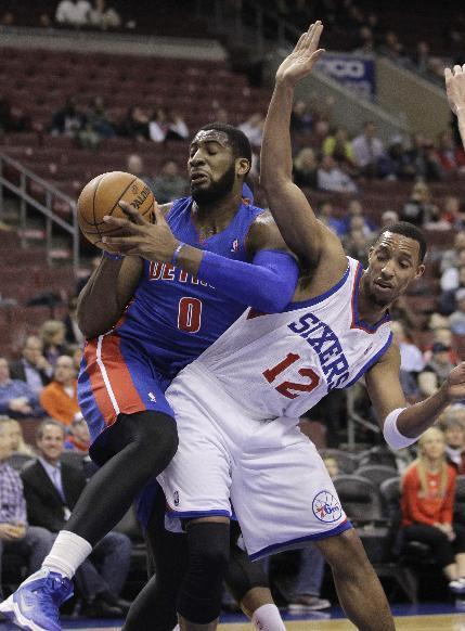 Detroit Pistons' Andre Drummond (0) tries to get around Philadelphia 76ers' Evan Turner (12) under the Piston basket in the first half of an NBA basketball game on Friday, Jan. 10, 2014, in Philadelphia. (AP Photo/Laurence Kesterson)