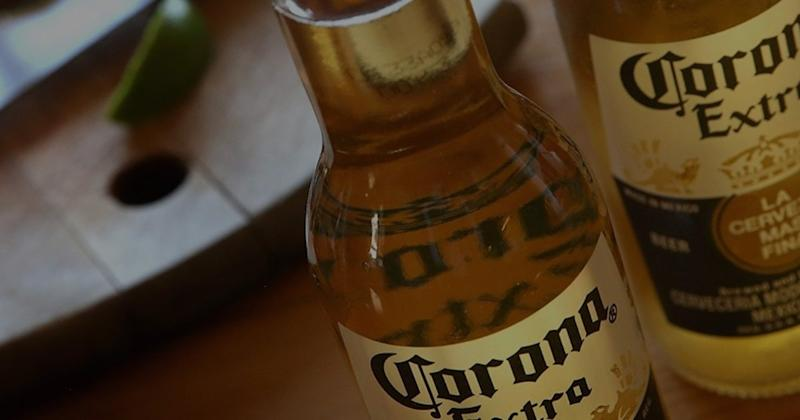 Two bottles of Corona Extra on a table.