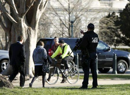 A United States Capitol Police officer directs people away from the U.S. Capitol in Washington March 29, 2016. REUTERS/Gary Cameron