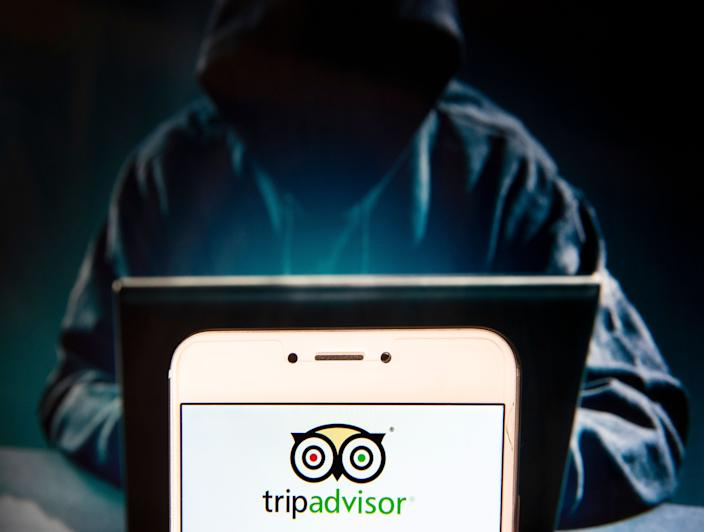 HONG KONG, CHINA - 2018/12/02:  In this photo illustration, the American travel agency and restaurant website company TripAdvisor logo is seen displayed on an Android mobile device with a figure of hacker in the background. (Photo Illustration by Miguel Candela/SOPA Images/LightRocket via Getty Images)