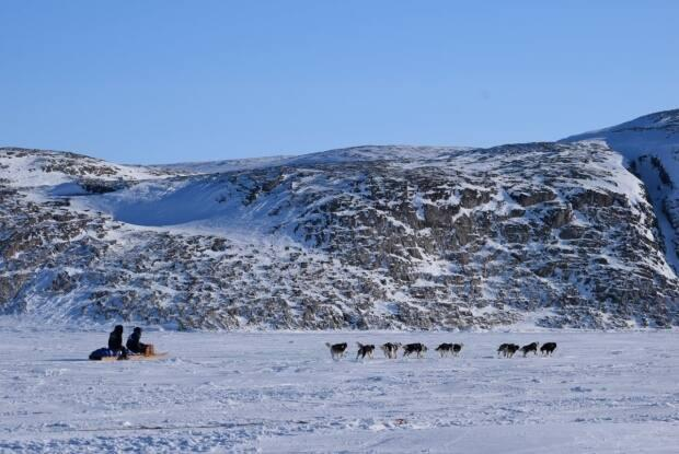 A team of mushers departs from Ivujivik in northern Quebec during the 2021 Ivakkak race. The race ended up taking a week longer than expected due to bad weather.