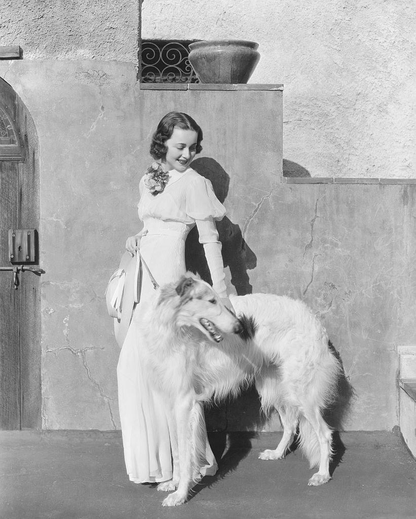 <p>Olivia and her dog standing outside the California Riverside Mission.</p>