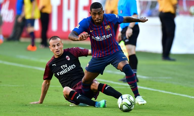 Malcom (R) in action for Barcelona in a friendly against AC Milan