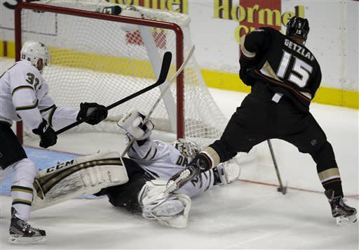 Anaheim Ducks' Ryan Getzlaf, right, tries to score against Dallas Stars goalie Kari Lehtonen during the third period of an NHL hockey game in Anaheim, Calif., Wednesday, April 3, 2013. The Ducks won 5-2. (AP Photo/Jae C. Hong)