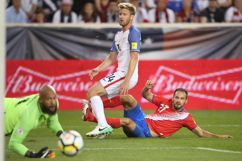 It was a rought night for Tim Ream (14), Tim Howard (bottom left) and the U.S. national team. (Getty)