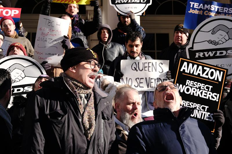George Miranda, vice president of the International Brotherhood of Teamsters, left, and Stuart Appelbaum, president of the Retail Wholesale Department Store Union (RWDU), speak during a protest against Amazon outside of City Hall in New York, U.S., on Wednesday, Jan. 30, 2019. New York's city council held a hearing today to discuss the tax incentives behind Amazon's HQ2 deal and the potential impact it could have on the city. Photographer: Sangsuk Sylvia Kang/Bloomberg via Getty Images