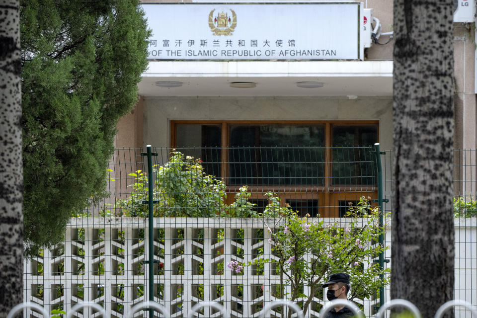 A Chinese security officer stands guard outside the Afghanistan Embassy in Beijing on Aug. 20, 2021. In the U.S. departure from Afghanistan, China has seen the realization of long-held hopes for a reduction of the influence of a geopolitical rival in what it considers its backyard. Yet, it is also deeply concerned that the very withdrawal could bring instability to that backyard - Central Asia - and possibly even spill over the border into China itself in its heavily Muslim northwestern region of Xinjiang. (AP Photo/Mark Schiefelbein)