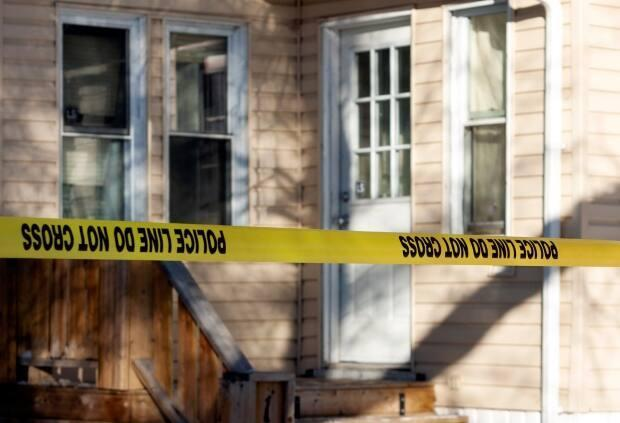 Police were on scene investigating an adult man's death on the 1000 block of Garnet Street on Sunday morning. Three men have now been charged in connection with the death of Justin Robert Delorme, 32. (Bryan Eneas/CBC - image credit)
