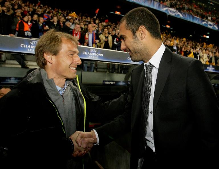 Pep Guardiola (R) shakes hands with Jurgen Klinsmann before a Champions League match in April 2009, but the pair had very different experiences as head coach of Bayern Munich