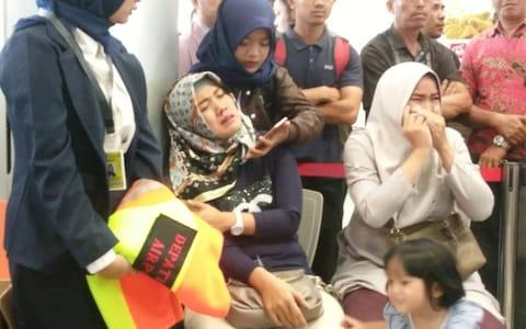 Relatives of passengers of Lion Air flight JT610 that crashed into the sea, cry at Depati Amir airport in Pangkal Pinang - Credit: Reuters