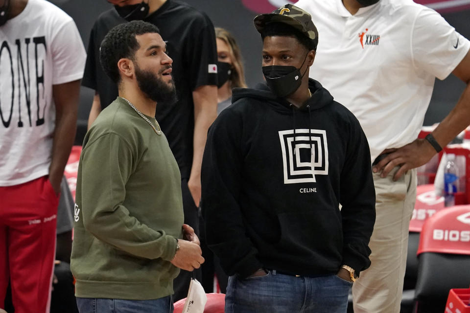 Toronto Raptors guard Fred VanVleet, left, and guard Kyle Lowry talk during the second half of an NBA basketball game against the Indiana Pacers Sunday, May 16, 2021, in Tampa, Fla. (AP Photo/Chris O'Meara)