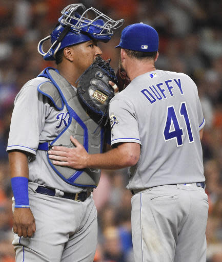 Kansas City Royals catcher Salvador Perez, left, talks with starting pitcher Danny Duffy after Duffy walked Houston Astros' Carlos Correa to load the bases during the sixth inning of a baseball game, Friday, June 22, 2018, in Houston. (AP Photo/Eric Christian Smith)