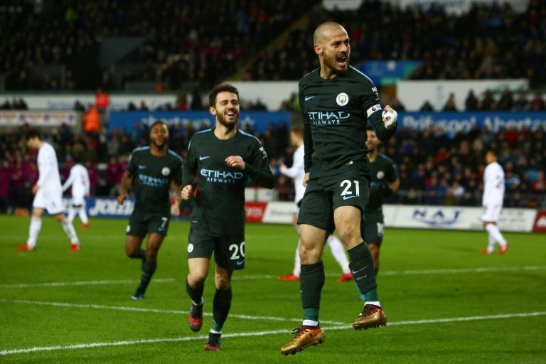 Manchester City's David Silva celebrates after scoring team's third goal during their English Premier League match against Swansea City, at The Liberty Stadium in Swansea, on December 13, 2017