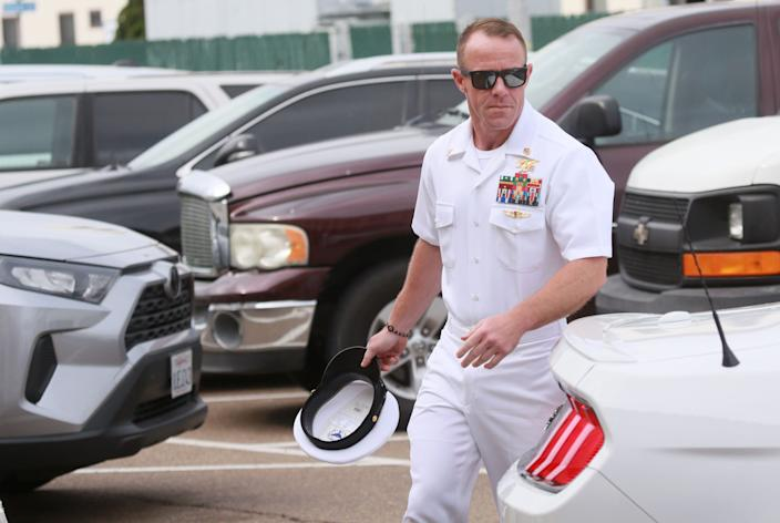 Navy SEAL Edward Gallagher walks into military court in San Diego, California, June 21, 2019.