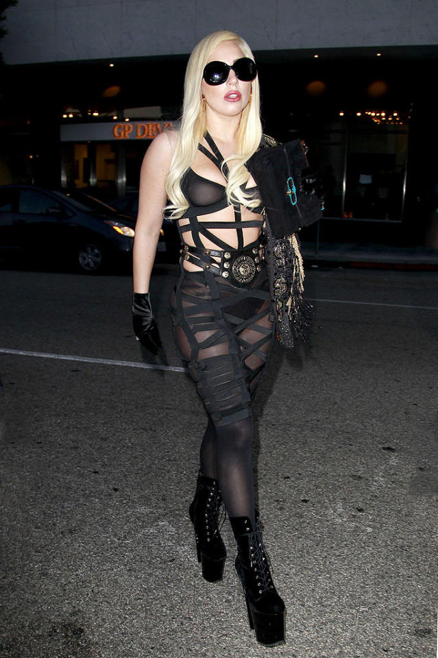 "Lady Gaga has been MIA for the last few weeks, but she instantaneously  commanded attention upon reemerging on Tuesday night in this  dominatrix-inspired getup. Wearing a barely-there, bandaged leotard,  velvet gloves, and suede platform heels, the ""Born This Way"" songstress  clomped her way into Mr. Chow in Beverly Hills for a bite to eat.  Hopefully her obscene ensemble didn't upset the stomachs of any fellow  diners, but we wouldn't be surprised if it did. (7/10/2012)<br> <br> <a target=""_blank"" href=""http://bit.ly/lifeontheMlist"">Follow What Were They Thinking?! creator, Matt Whitfield, on Twitter!</a>"