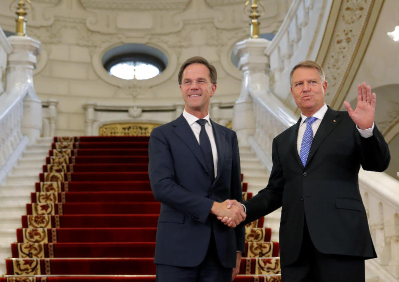 Dutch Prime Minister Mark Rutte, left, shakes hands with Romanian President Klaus Iohannis at the Cotroceni Presidential Palace in Bucharest, Romania, Wednesday, Sept. 12, 2018. Rutte is on a one day official visit to Romania.(AP Photo/Vadim Ghirda)