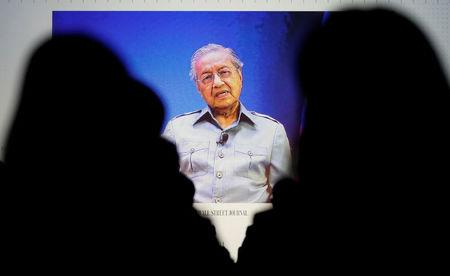 Mahathir tells WSJ he expects charges to be filed against Najib