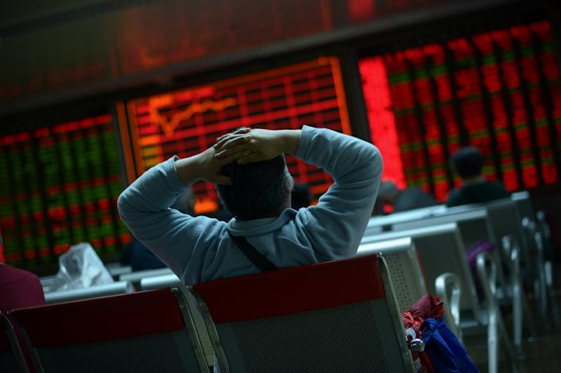 Stock markets are in the red as investors dump shares, worried about Donald Trump's ability to boost the economy (AFP Photo/WANG ZHAO)