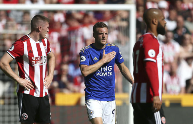 Leicester City's Jamie Vardy, centre, celebrates scoring his side's first goal of the game during the English Premier League soccer match between Sheffield United and Leicester City at Bramall Lane stadium, Sheffield, England. Saturday, Aug, 10 2019. (Richard Sellers/PA via AP)