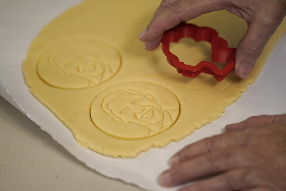 Julie Muller, who sells cookie decorating kits on Etsy, makes cutout cookies with the likeness of President Obama Tuesday, Sept. 22, 2020, in Houston. One of the cookie-decorating kits she offers has a Black Lives Matter theme. Amid all the Black Lives Matter themed T-shirts, face masks and signs appearing in recent months, some unconventional merchandise has been popping up on online crafts marketplace Etsy. (AP Photo/David J. Phillip)