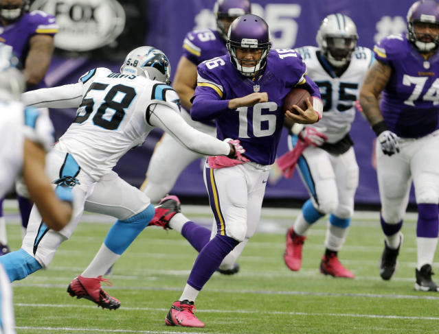 Carolina Panthers outside linebacker Thomas Davis, left, chases down Minnesota Vikings quarterback Matt Cassel (16) as he runs during the first half of an NFL football game in Minneapolis, Sunday, Oct. 13, 2013. (AP Photo/Ann Heisenfelt)