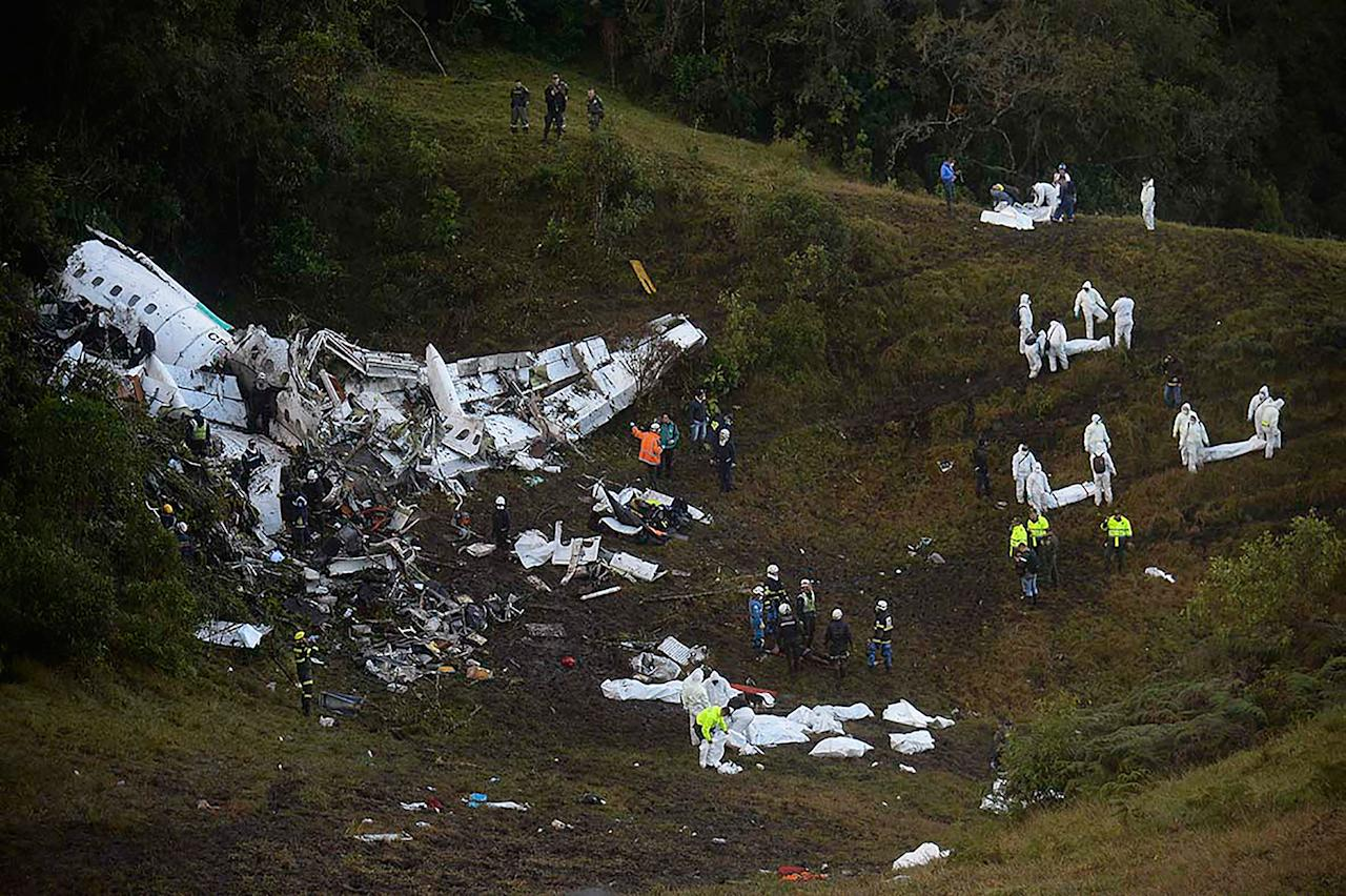 <p>Rescuers search for survivors from the wreckage of the LAMIA airlines charter plane carrying members of the Chapecoense Real football team that crashed in the mountains of Cerro Gordo, municipality of La Union, on Nov. 29, 2016. (Raul Arboleda/AFP/Getty Images) </p>