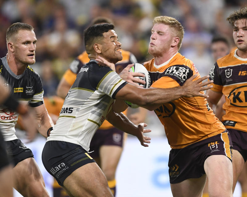 Thomas Flegler of the Broncos is tackled by Esan Marsters of the Cowboys during the round 1 NRL match between the North Queensland Cowboys and the Brisbane Broncos at Queensland Country Bank Stadium on March 13, 2020 in Townsville, Australia. (Photo by Ian Hitchcock/Getty Images)