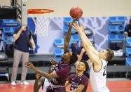 Texas Southern forward Joirdon Karl Nicholas (5), left, and Mount St. Mary's forward Frantisek Barton (24) battle for a rebound during the first half of a First Four game in the NCAA men's college basketball tournament, Thursday, March 18, 2021, in Bloomington, Ind. (AP Photo/Doug McSchooler)