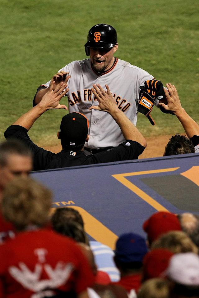 ARLINGTON, TX - OCTOBER 31: Aubrey Huff #17 (R) of the San Francisco Giants is congratulated by teammates after his two-run home run in the top of the third inning against the Texas Rangers in Game Four of the 2010 MLB World Series at Rangers Ballpark in Arlington on October 31, 2010 in Arlington, Texas. (Photo by Ronald Martinez/Getty Images)