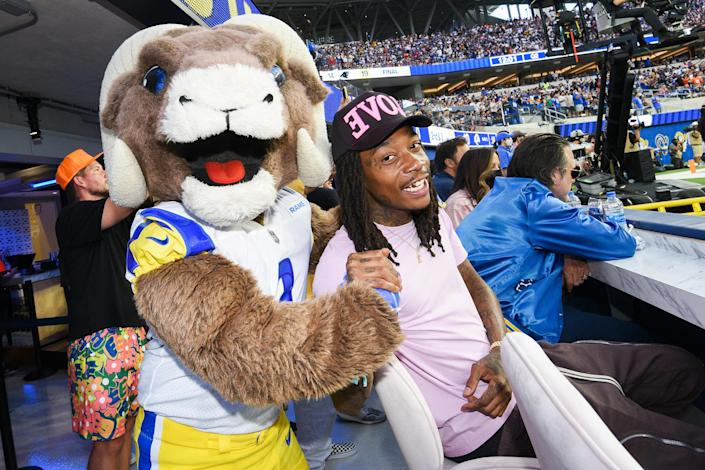 <p>Rampage, the NFL mascot for the Los Angeles Rams, and Wiz Khalifa attend Bootsy Bellows at SoFi Stadium's opening day on Sept. 12 in Inglewood, California.</p>