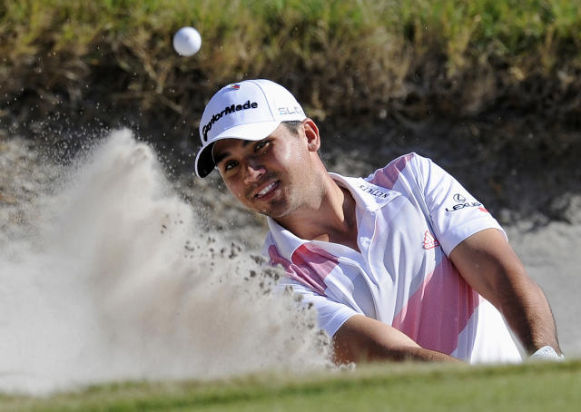 Jason Day of Australia hits out of a green side bunker on the 15th hole during the first round of the World Cup of Golf at Royal Melbourne Golf Course in Melbourne, Australia, Thursday, Nov. 21, 2013. (AP Photo/Andy Brownbill)