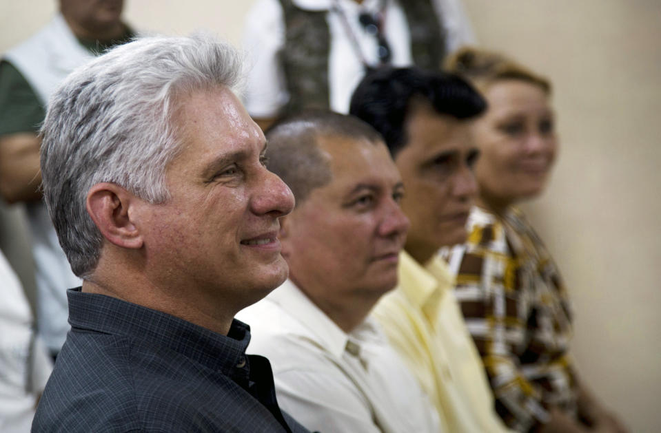FILE - In this Jan. 16, 2020 file photo, Cuba's President Miguel Diaz-Canel, left, attends a meeting in an art school during a tour in Las Tunas, Cuba. On Monday, April 19, 2021, Cuba's Communist Party congress chose Díaz-Canel to be its leader, adding that post to the title of president he assumed in 2018, replacing his mentor Raul Castro and sealing a political dynasty that had held power since the 1959 revolution. (AP Photo/Ismael Francisco, File)