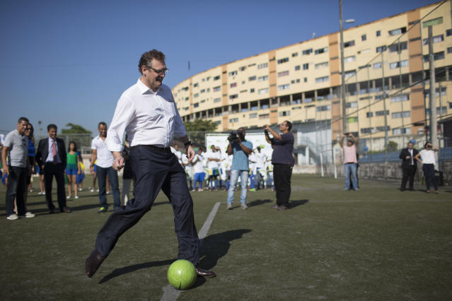 FIFA Secretary General Jerome Valcke kicks a soccer ball during a visit to the Bola pra Frente Institute in Rio de Janeiro, Brazil, Thursday, Jan. 23, 2014. The institute is part of FIFA's Football for Hope project that aims to give kids healthy and creative outlets through soccer, education, art and culture. Brazil will host the World Cup in 2014, starting in June. (AP Photo/Felipe Dana)