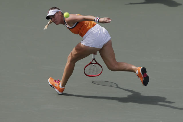 Timea Babos of Hungary returns a shot to Jelena Ostapenko of Latvia during their first round match of the Korea Open tennis championships in Seoul, South Korea, Tuesday, Sept. 17, 2019. (AP Photo/Lee Jin-man)