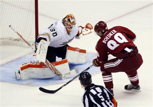 Anaheim Ducks goalie Viktor Fasth (30) of Sweden, makes the save on Phoenix Coyotes right wing Mikkel Boedker (89) of Denmark, in the second period of an NHL hockey game Saturday, March 2, 2013, in Glendale, Ariz. (AP Photo/Rick Scuteri)