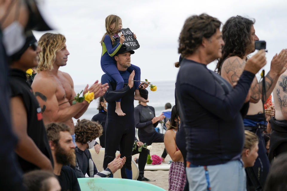 "Surfers participate in a paddle out ceremony at ""The Ink Well,"" a beach historically known as a surfing refuge for African Americans, to honor the life of George Floyd on Friday, June 5, 2020, in Santa Monica, Calif. Floyd died after he was restrained in police custody on Memorial Day in Minneapolis. (AP Photo/Ashley Landis)"