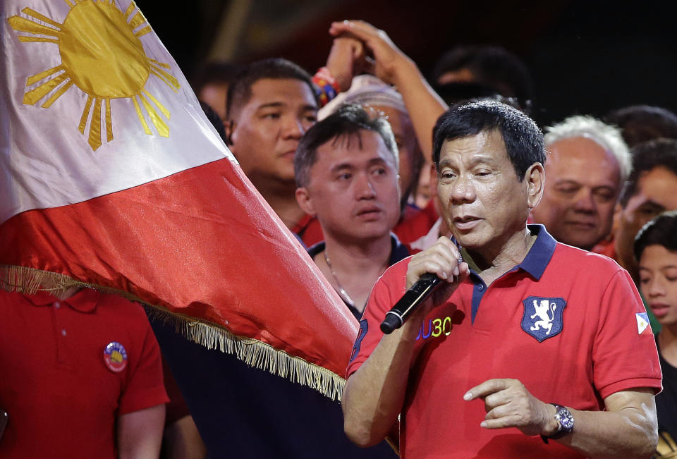 FILE PHOTO: Philippine presidential race front-runner Davao city mayor Rodrigo Duterte talks to the crowd during his final campaign rally in Manila, Philippines on Saturday, May 7, 2016. (AP Photo/Aaron Favila)