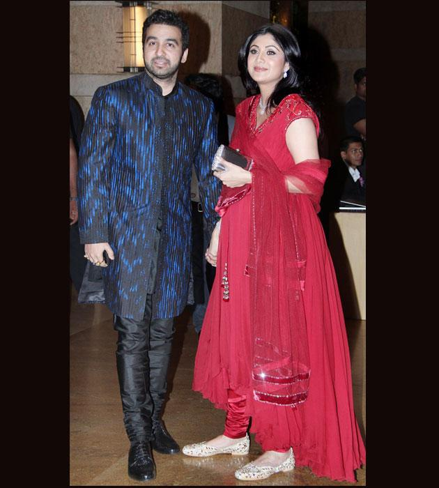 Shilpa wore a bright colour anarkali suit and looked very pretty in it as she walked in with her husband Raj Kundra for the Deshmukh - Bhagnani sangeet ceremony.