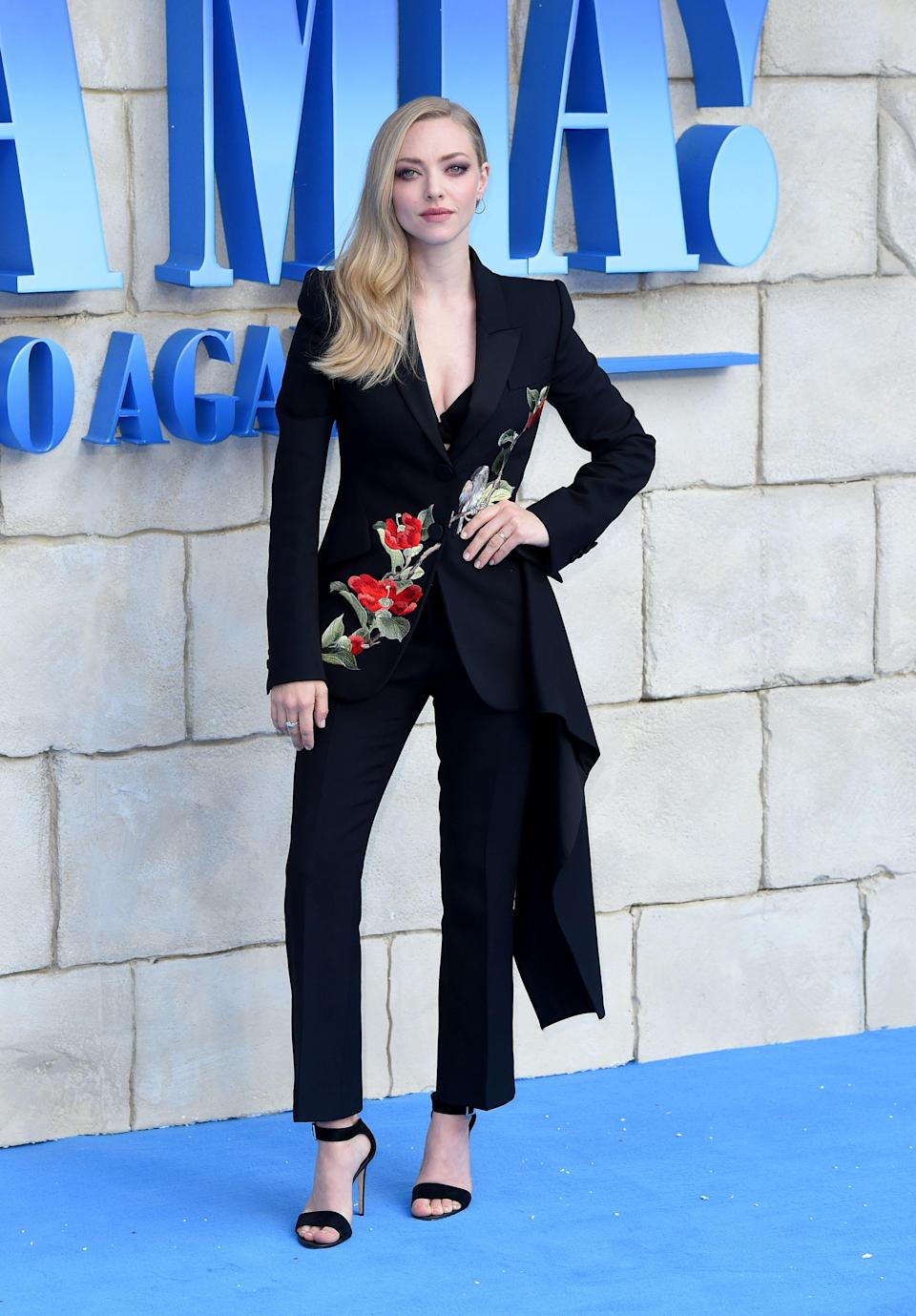 <p>On 16 July, Amanda Seyfried opted for a floral suit by Alexander McQueen for the UK premiere of 'Mamma Mia! Here We Go Again'. <em>[Photo: Getty]</em> </p>