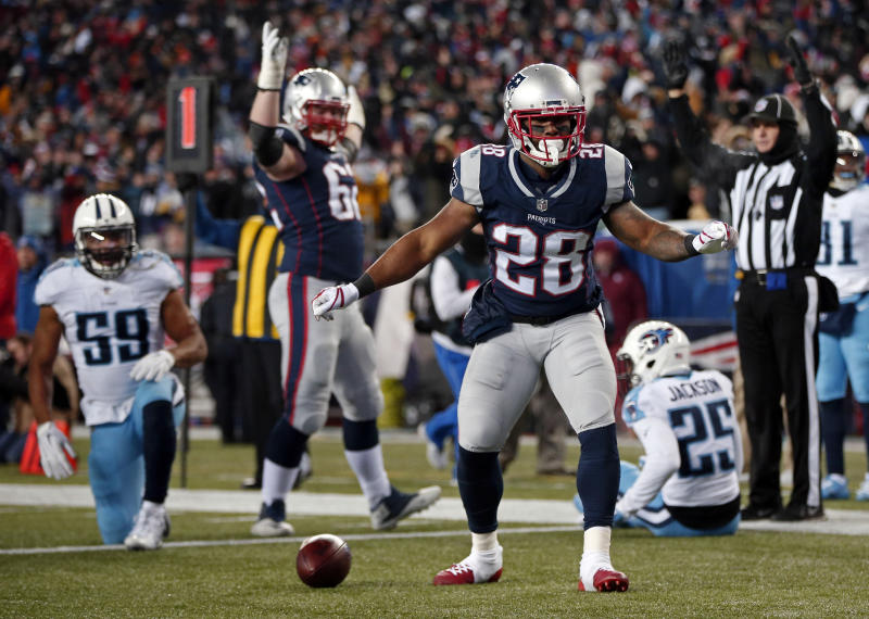 New England Patriots running back James White celebrates a touchdown against the Titans. (AP)