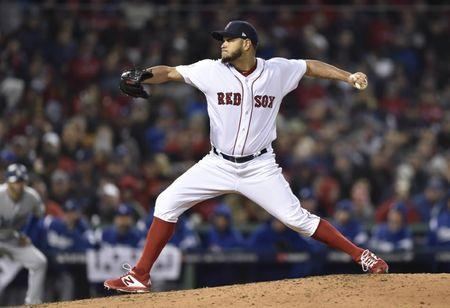 Oct 23, 2018; Boston, MA, USA; Boston Red Sox pitcher Eduardo Rodriguez throws a pitch against the Los Angeles Dodgers in the seventh inning in game one of the 2018 World Series at Fenway Park. Mandatory Credit: Bob DeChiara-USA TODAY Sports