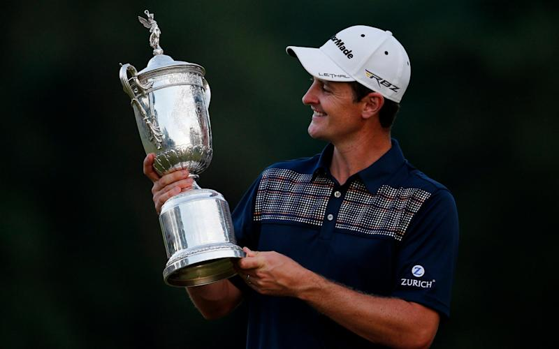 England's Justin Rose celebrates winning the US Open Championship with the trophy - ACTION IMAGES