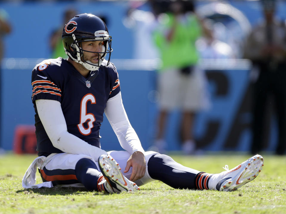 FILE - In this Oct. 5, 2014, file photo, Chicago Bears' Jay Cutler sits on the ground after being hit after a pass against the Carolina Panthers during the second half of an NFL football game in Charlotte, N.C. Carolina was down 21-7, but won 31-24. A double-digit deficit is no longer the death knell it used to be in the NFL. (AP Photo/Bob Leverone, File)