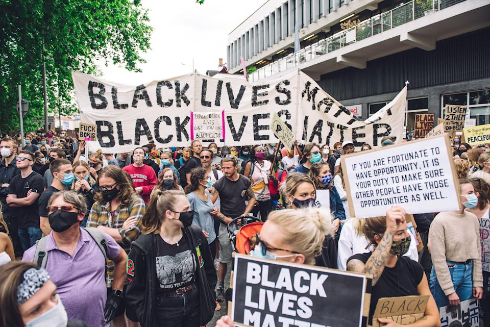 Crowd marches in front of Colston Hall, concert venue dedicated to Edward Colston, a slave trader who lived in the 17th century and played a major role in the development of the city of Bristol, England, on June 7, 2020. (Photo by Giulia Spadafora/NurPhoto via Getty Images)