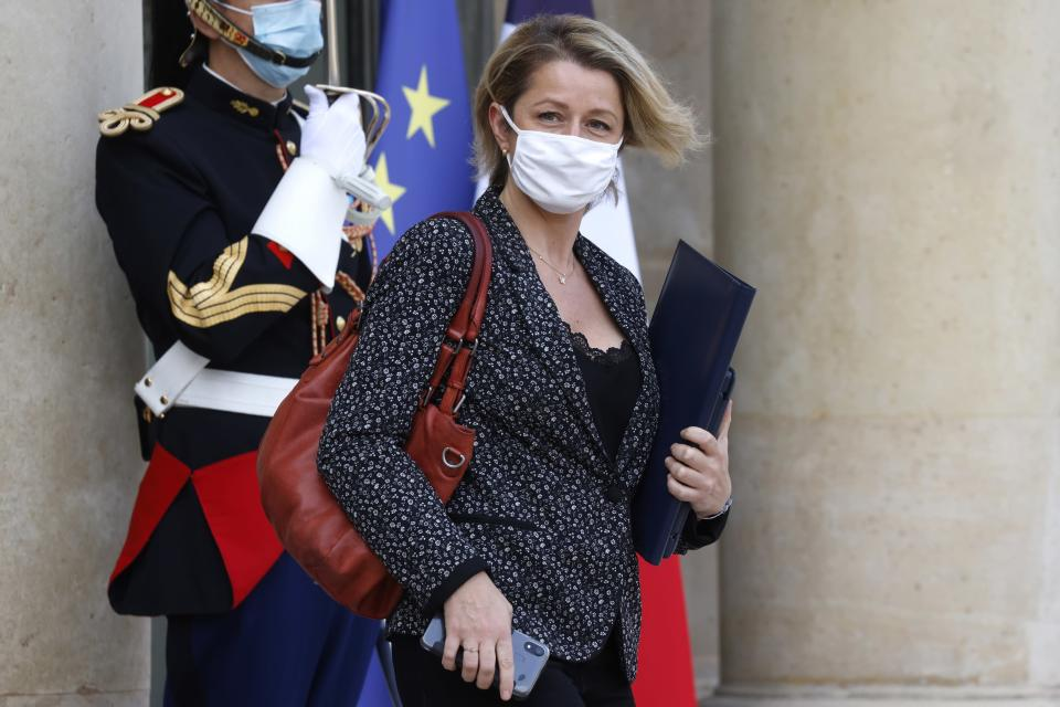 French Ecological Transition Minister Barbara Pompili, wearing a face mask, leaves after the weekly cabinet meeting at the Elysee Palace in Paris