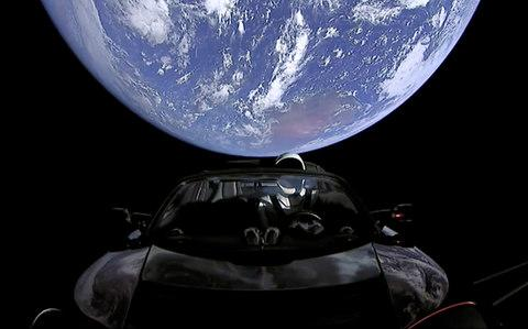 Images show the car in space - Credit:  SpaceX