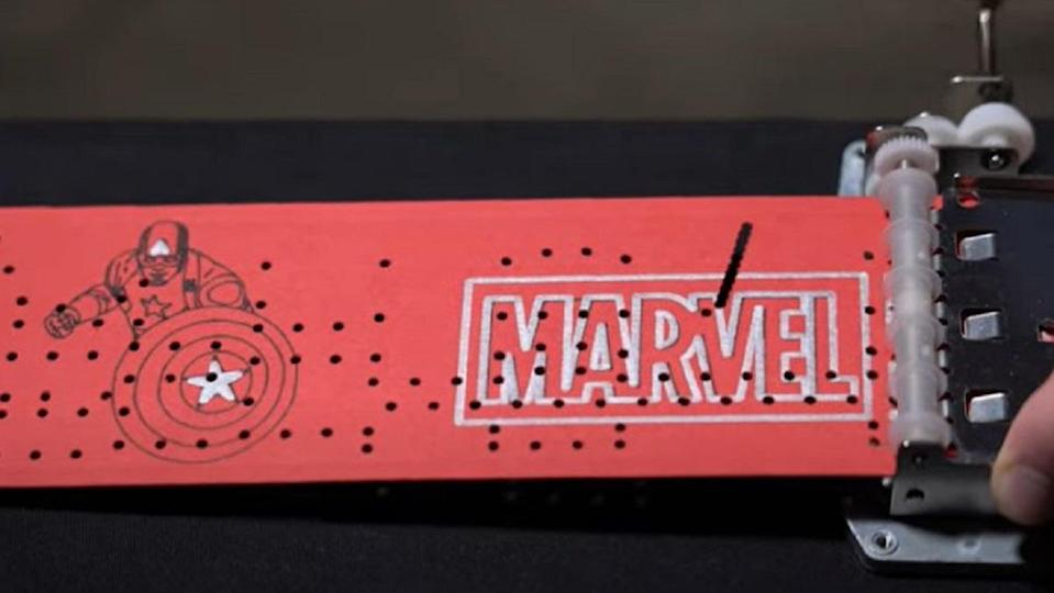 An image of a Marvel Studios music box scroll