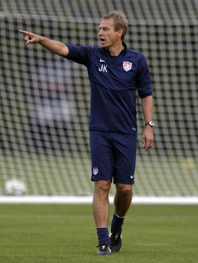United States' head coach Jurgen Klinsmann talks to his players during a training session in Sao Paulo, Brazil, Saturday, June 28, 2014. The U.S. will play against Belgium on Tuesday, July 1, in the round 16 of the 2014 soccer World Cup. (AP Photo/Julio Cortez)